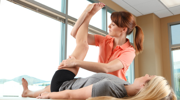 woman physical therapist at work